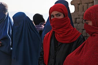 Woman wearing red-and-blue hijab headscarfs