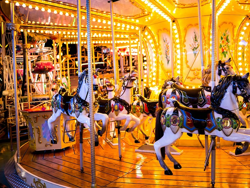 Selective focus photography of merry-go-round during nighttime