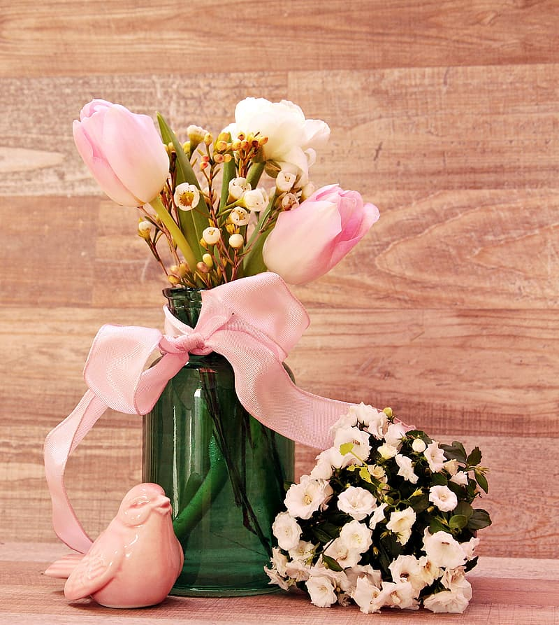 Pink flowers in green glass vase