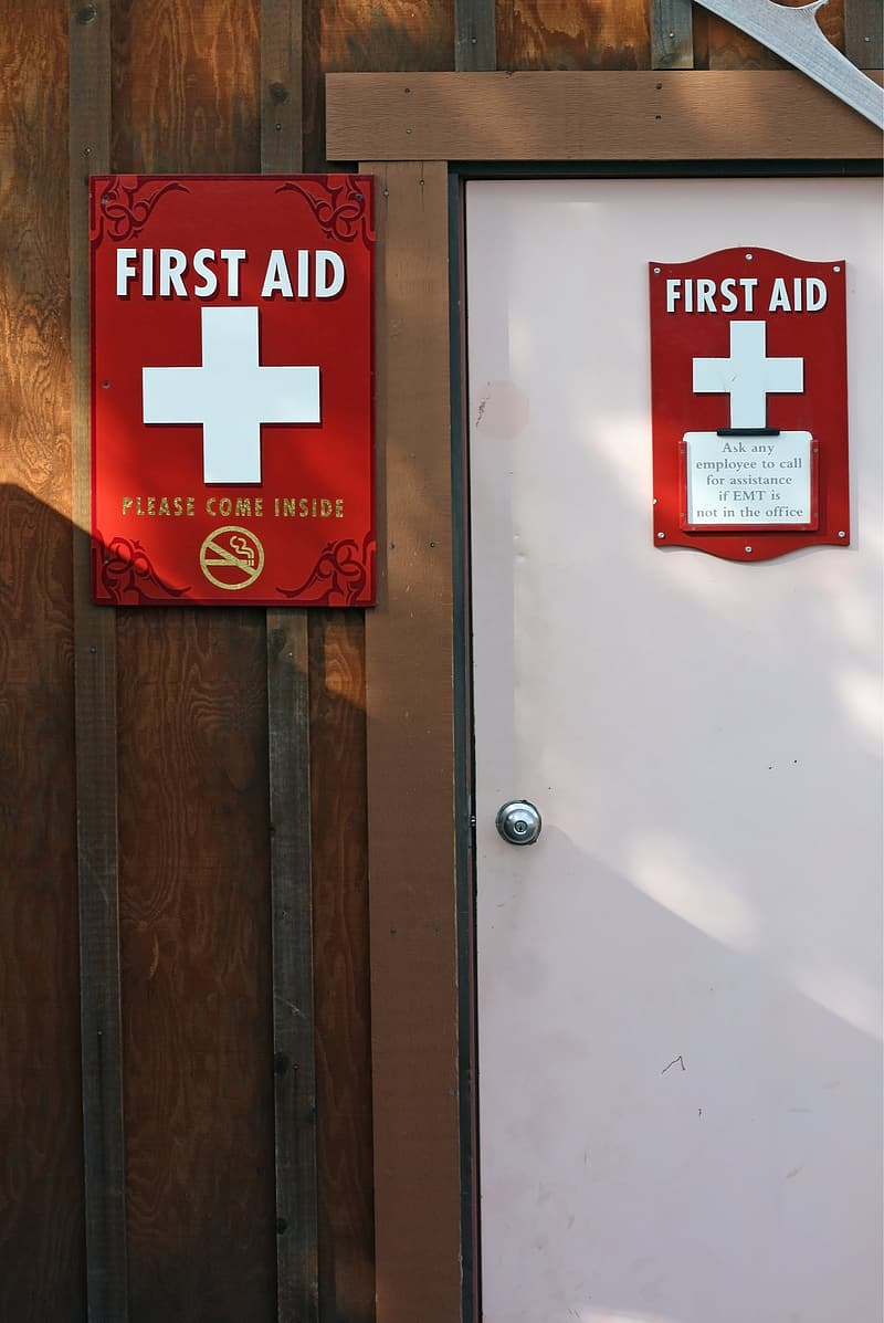 First Aid signage on door