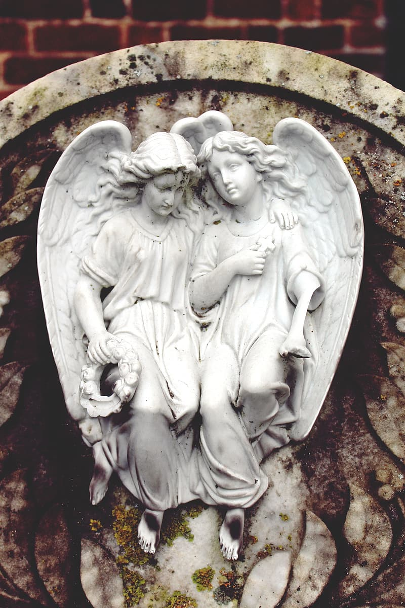 Two angel statue during daytime