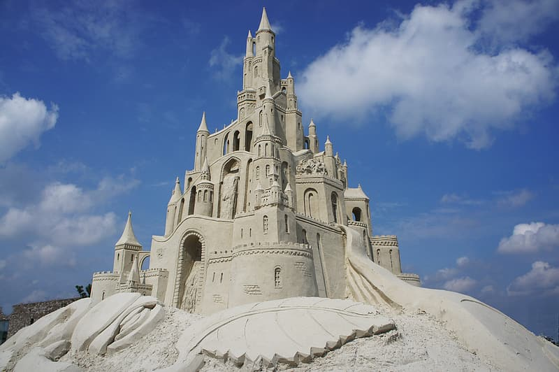 Sand castle under blue and white skies