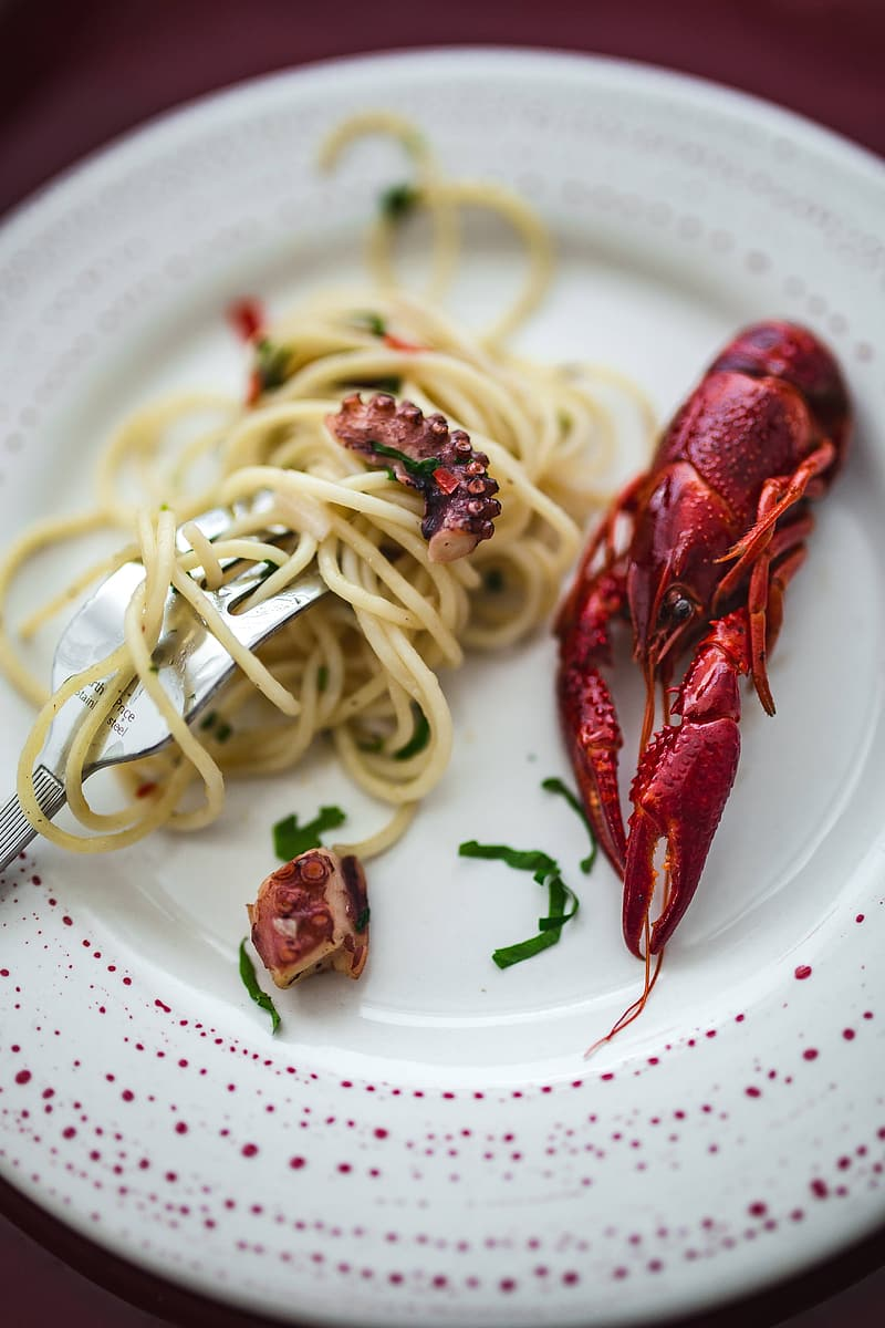 Pasta with red chili on white ceramic plate