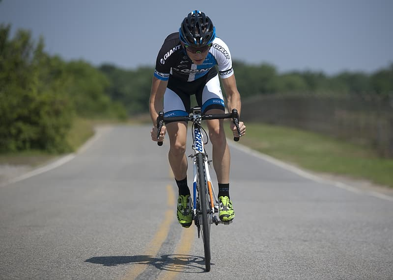 Man riding road bike in the highway