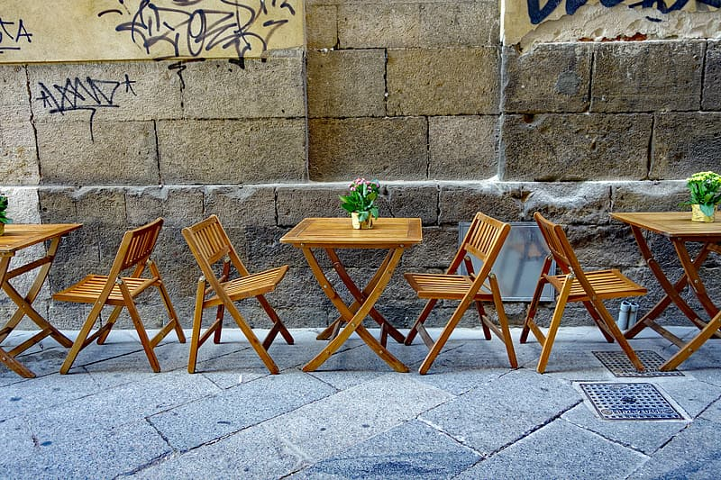 Brown wooden folding table and chairs