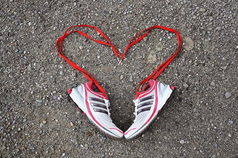 White and red running shoes