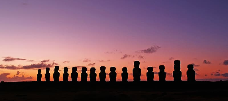 Panoramic photo of Moai statues during golden hour