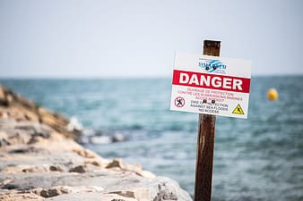 Danger signage over body of water
