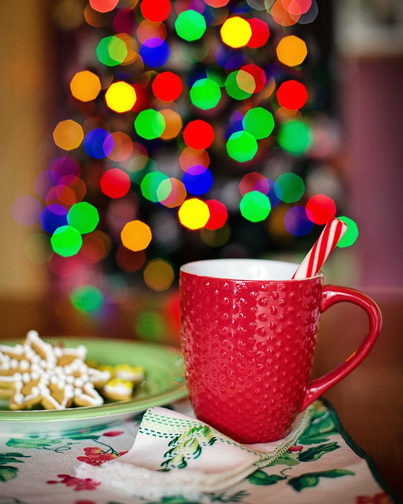 Selective focus photo of red mug with candy cane