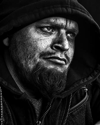 Black and white photo of man with hooded jacket