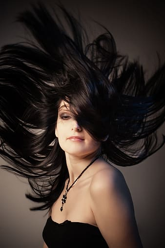 Woman flipping hair photography