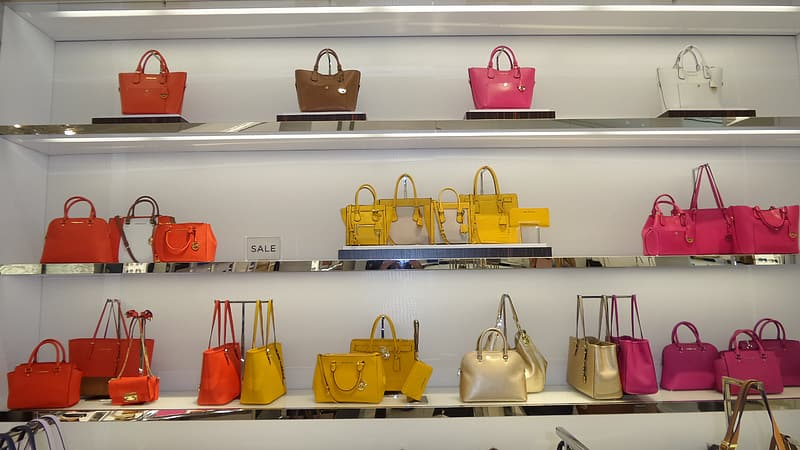Assorted-color bag display on gondola shelf