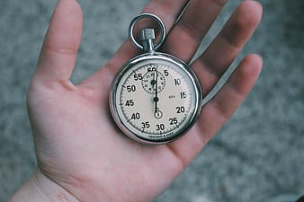 Person holding pocket watch
