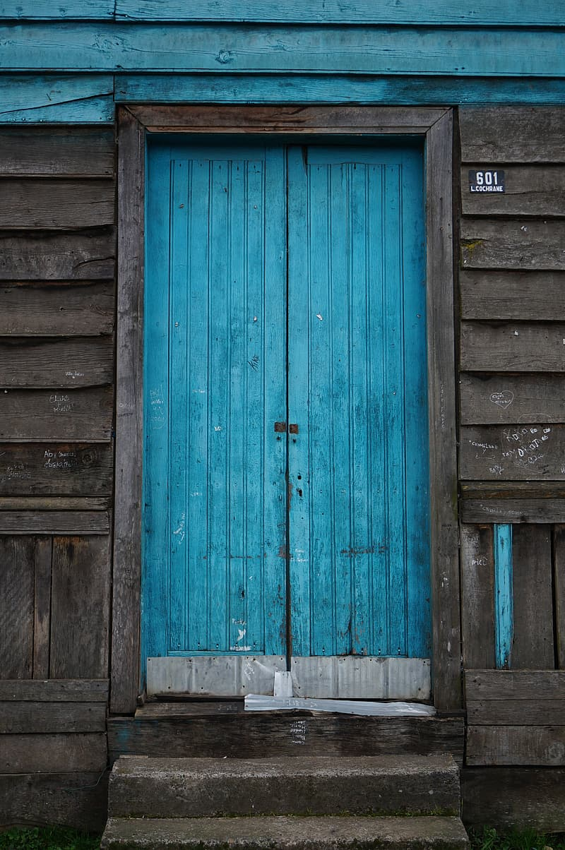 Photo of closed teal door