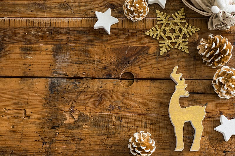 White star ornament on brown wooden surface