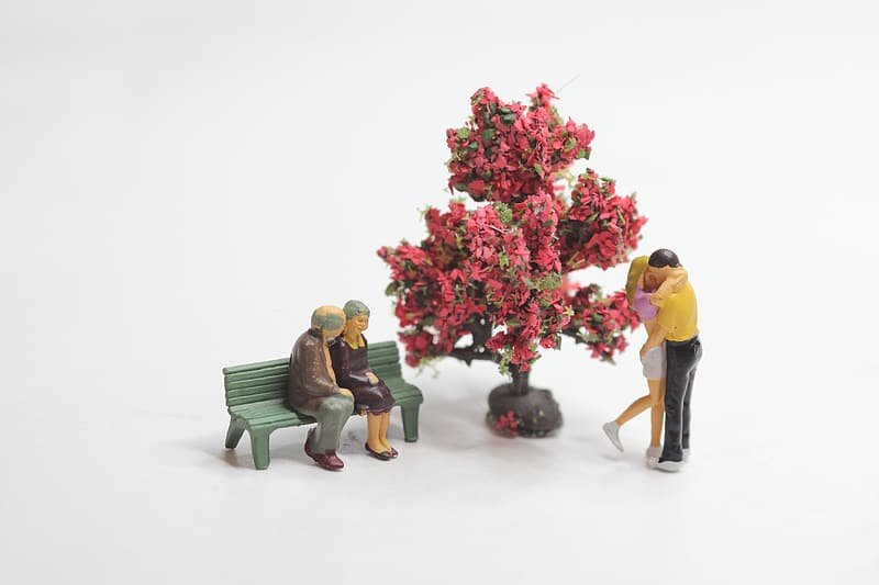 Two couples and tree figurines