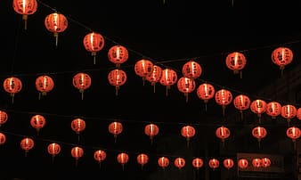 Low angle photo of lighted Chinese lanterns