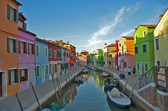 Architectural photography of multicolored building and boats during daytime