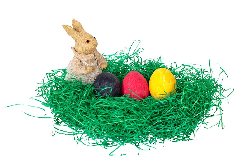 Brown rabbit figurine and eggs in nest