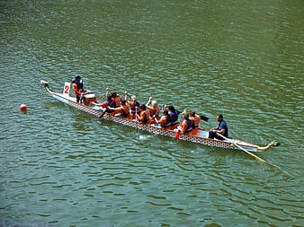 People riding dragon boat