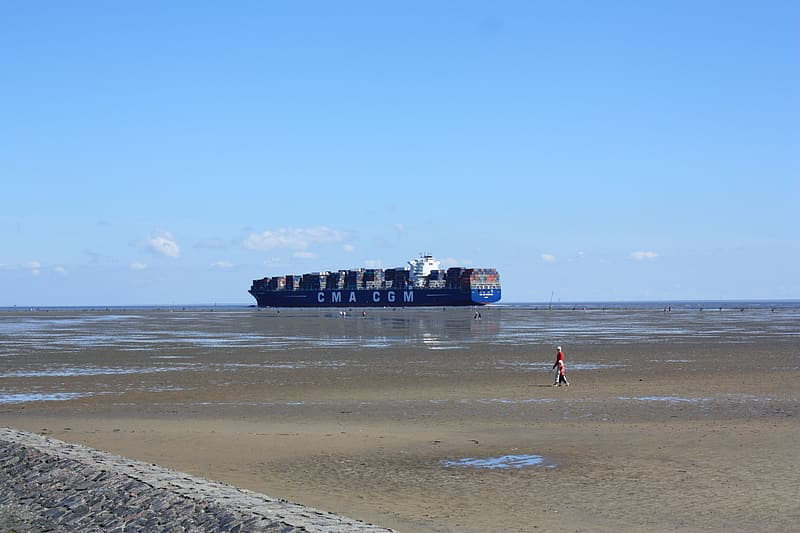 Blue and white ship on sea during daytime