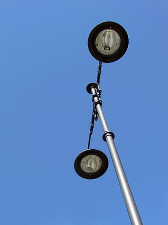 Gray and black post lamp during daytime