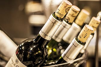White labeled bottles with corks