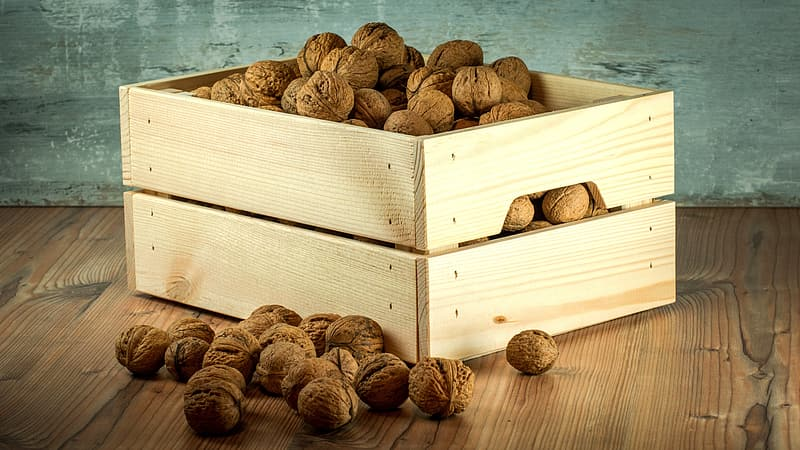Brown wooden crate with nuts