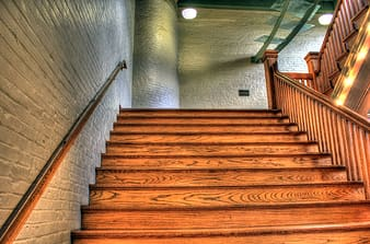 Photo of brown wooden stairs