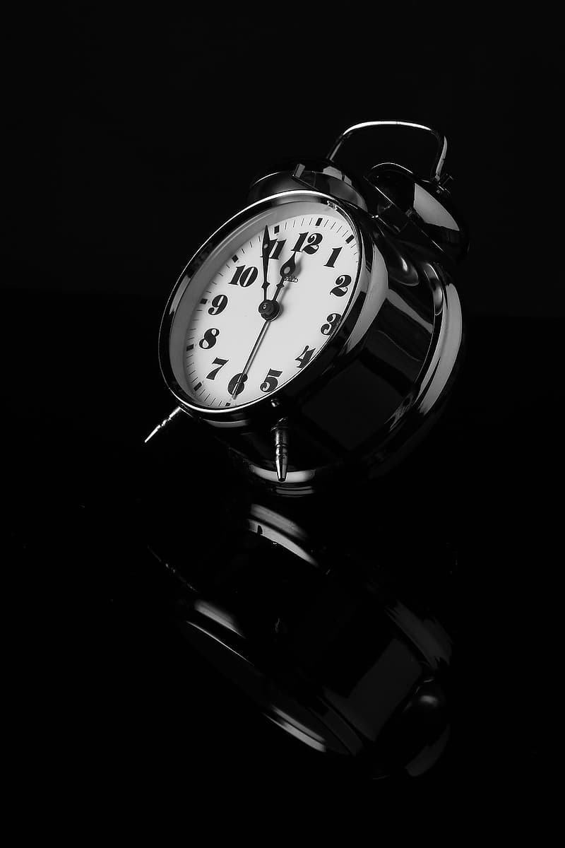 White and black table alarm clock