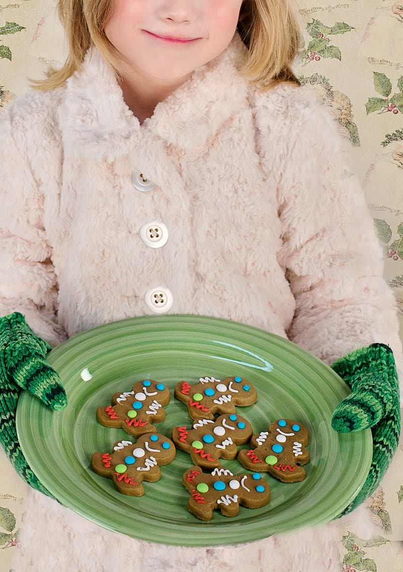 Girl holding green plate with gingerbreads