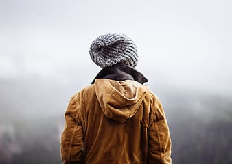 Brown hoodie jacket and gray knit hat