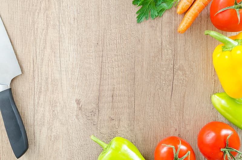 Top view photography of variety of vegetables on brown wooden surface