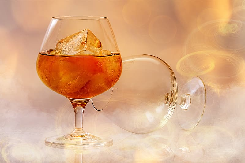Two beverage clear wine footed glasses
