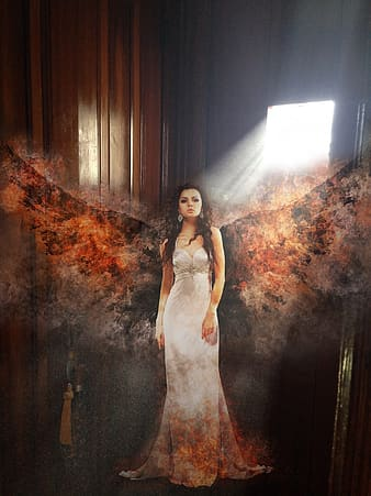 Woman with burning wings standing near door
