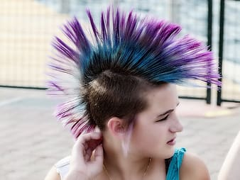 Woman with purple and blue mohawk hairstyle