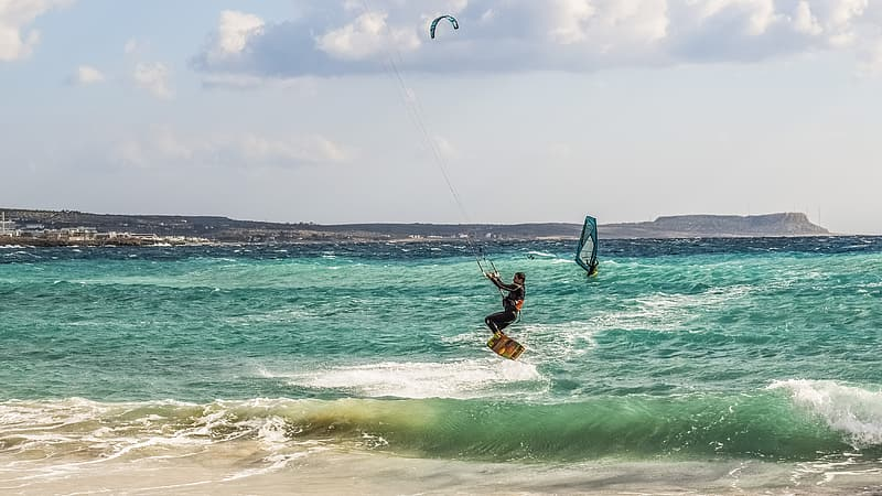 Man in black shorts surfing on sea during daytime