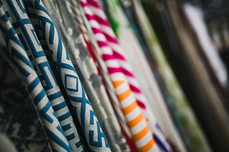 Collection of design fabrics on hangers