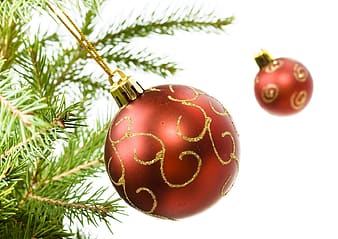 Red bauble on green christmas tree