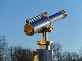 Gold and silver telescope during daytime