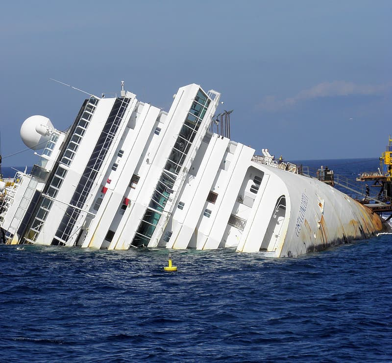 White cruise ship sinking on body of water