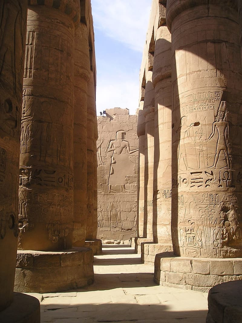 Brown concrete pillars with Egyptian calligraphy