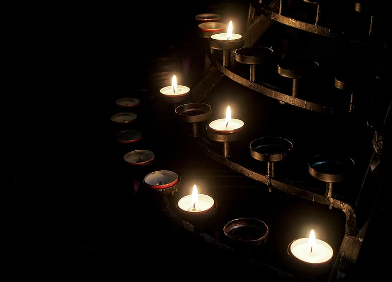 Lit white tealight candles