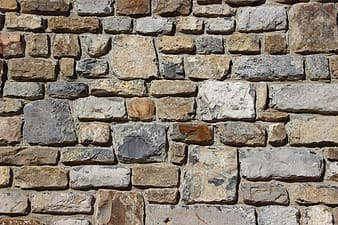 Brown and gray irregular pattern bricked wall