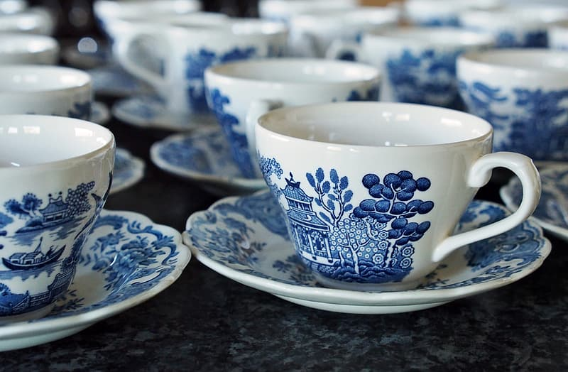 White and blue ceramic teacups and saucers
