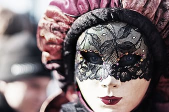 Woman with black lace mask