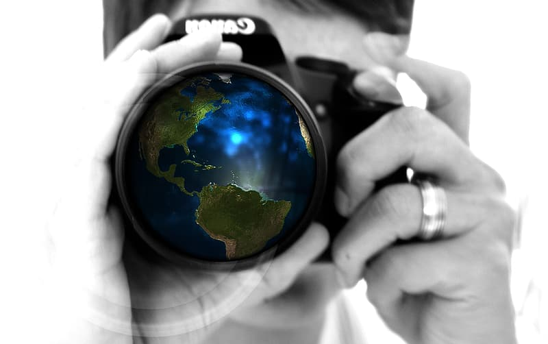 Macro photography of man with DSLR camera with globe lens display