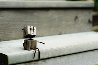 Brown wooden robot toy