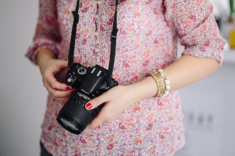 Woman in pink with her camera