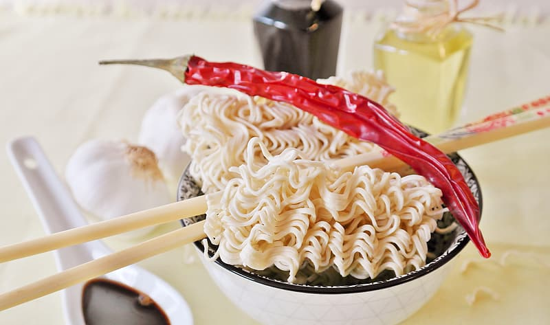 Noodle with chili on bowl